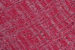Red openwork melange stockinet as background Royalty Free Stock Image