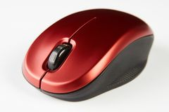 Red optical computer mouse. Wireless computer mouse on white background, close-up stock photos