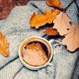 Red and Orange Autumn Leaves Background with coffee cup.  Yell Stock Photos