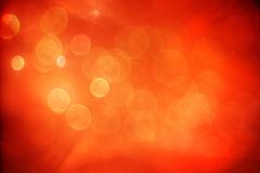 Red and orange background with bokeh lights Stock Photos