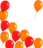 Red and orange balloons. On white background Stock Image