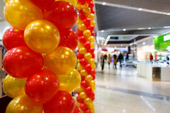 Red and orange balloons in mall. Royalty Free Stock Photography