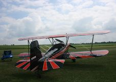 Red and orange biplane Stock Image