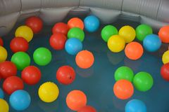 Colorful plastic balls in the water royalty free stock images