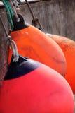 Red and orange buoys Stock Photo