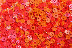 Red and orange buttons (clasper) Stock Photo