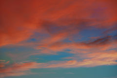 Red orange clouds in dramatic sunset sky Royalty Free Stock Photography