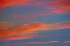 Red orange clouds in dramatic sunset sky Royalty Free Stock Photos