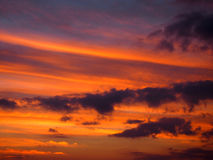 Red Orange Cloudy Sky at Dusk Royalty Free Stock Photo
