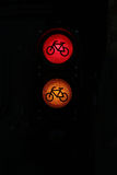 Red and orange colored traffic lamps Stock Photos