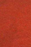 Red orange felt. Close up of red orange sparkled felt textile Stock Photos