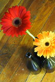 Red and Orange Flowers. In Wine Bottles Royalty Free Stock Photo