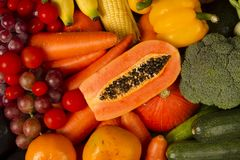 Red and orange of Fruits and vegetables mixed together at groceries desk Stock Image
