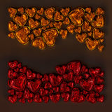Red and orange glass hearts Stock Image