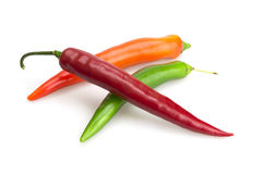 Red orange and green chili peppers Stock Photos