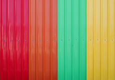Red orange green yellow corrugated metal sheet as background Stock Images