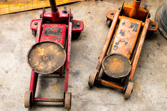 Red and Orange Hydraulic car jack Stock Photography