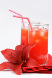 Red orange juice and lily Royalty Free Stock Photos
