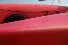 Red and Orange Kayak in storage Royalty Free Stock Image