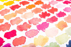 Red, orange and magenta watercolours on paper royalty free stock photos