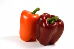Red and Orange Peppers. Colorful fresh bell peppers Royalty Free Stock Photography