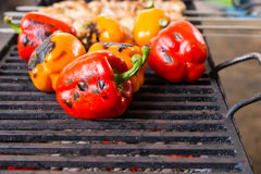 Red and Orange Peppers Cooking on Outdoor Grill Stock Photos