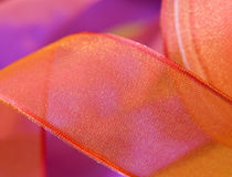 Red and orange ribbon bow curls close up Stock Image