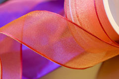 Red and orange ribbon bow curls close up Royalty Free Stock Photos