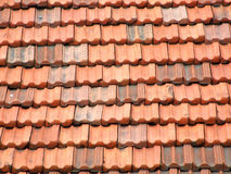Red and orange roof tiles. On an Italian residential building in a small town. Ceramic slate roof Royalty Free Stock Photo