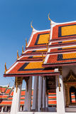 Red and Orange Roofs against a dark blue sky at Grand Palace, Thailand Stock Photos