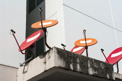 Red and orange satellite dishes Stock Image