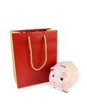 Red-orange shopping bag and piggy bank isolated Stock Photo