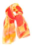 A red and orange silk scarf. Isolated on white background Stock Photography