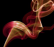 Red with orange smoke on the black background Stock Images