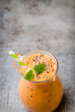 Red Orange Smoothie, decor mint leaves. Stock Photography