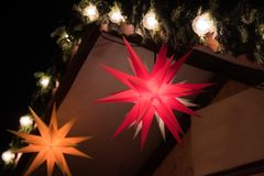 Red and orange spike explosive star Christmas Light Decoration. Red and orange star lights decoration for Christmas in front of a house royalty free stock photography