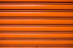 Red-orange steel roller door stock photo