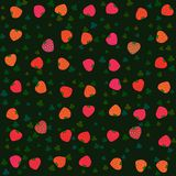 Red orange strawberries on green background Stock Photos