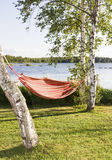 Red and orange striped hammock in sunshine Stock Photography