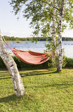 Red and orange striped hammock in sunshine Stock Photos