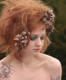 Red Orange Teased Hair with Dead Flowers Stock Photo