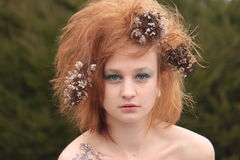 Red Orange Teased Hair with Dead Flowers Stock Image