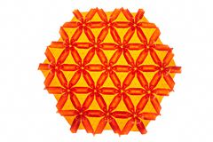 Red and orange tessellated origami. With flower elements. Complex artwork made by a professional Stock Image