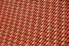 Red and Orange Tiles Background. Abstract red and orange roof tiles pattern royalty free stock photo
