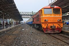 Red orange train, Diesel locomotive Stock Photo