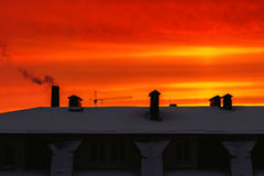 Red, orange, vivid sky at sunrise over the building in the city. Stock Image