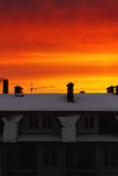 Red, orange, vivid sky at sunrise over the building in the city. Royalty Free Stock Photos