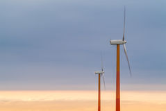 Red and orange wind turbines Stock Images