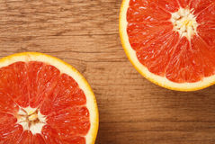 Red Orange on a Wooden Background Closeup Stock Photography