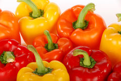 Red orange yellow bell peppers closeup Stock Photos